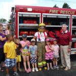 Mayor Reeves, Firefighter Mroz with Children