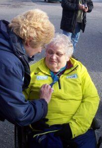 Municipal Clerk/Administrator Debbie Tonelli Admires the Medal