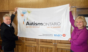 Mayor Reeves & Clerk Tonelli with Autism Ontario Flag
