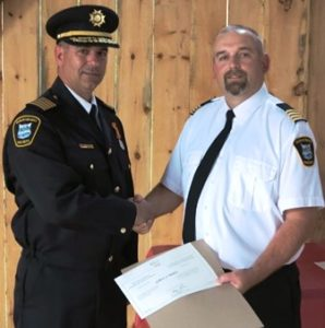 Deputy Chief DaveSmith (Station 1) Presents Chief Medve with his Certificate