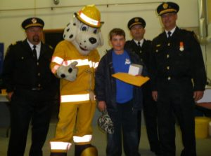 Winner of the Blue Jays Tickets with Deputy Chief Stn 2 Scott Richards, Sparky, Deputy Chief Stn 1 Dave Smith, & Fire Chief Gib Medve